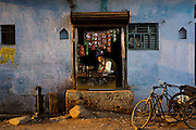 19th February 2013, Mahoba, Uttar Pradesh, India.   A man sits in his small shop in a daily life street scene in Mahoba, Uttar Pradesh, India on the 14th February 2013.<br /> <br /> Mahoba in UP is a place in India where women get a particularly poor deal with regard to their roles in society especially regarding reproductive freedom and health <br /> <br /> PHOTOGRAPH BY AND COPYRIGHT OF SIMON DE TREY-WHITE<br /> <br /> + 91 98103 99809<br /> + 91 11 435 06980<br /> +44 07966 405896<br /> +44 1963 220 745<br /> email: simon@simondetreywhite.com photographer in delhi
