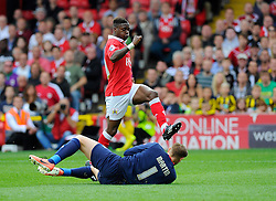 Milton Keynes Dons' David Martin beats Bristol City's Kieran Agard to the ball  - Photo mandatory by-line: Joe Meredith/JMP - Mobile: 07966 386802 - 27/09/2014 - SPORT - Football - Bristol - Ashton Gate - Bristol City v MK Dons - Sky Bet League One