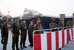 "October 5, 2018 - Lahore, Punjab, Pakistan - Police officers arrive to take positions for security at the office of National Accountability Bureau(NAB) following the opposition leader Shahbaz Sharif arrest, in Lahore on October 05, 2018. Pakistan's anti-graft body announced that it had arrested the country's opposition leader"" former Chief Minister Punjab and Pakistan Muslim League-Nawaz (PML-N) President Shahbaz Sharif, over his alleged links to a multi-million dollar Ashiana Housing Scheme. officials said, the latest corruption allegation against the Sharif political dynasty that was ousted from power by ex-cricketer Imran Khan in elections this summer (Credit Image: © Rana Sajid Hussain/Pacific Press via ZUMA Wire)"