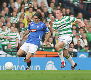 Rangers' Pedro Mendes is chased by Celtic's Scott Brown during the League Cup final between Rangers and Celtic at Hampden Park -<br /> David Young Universal News And Sport