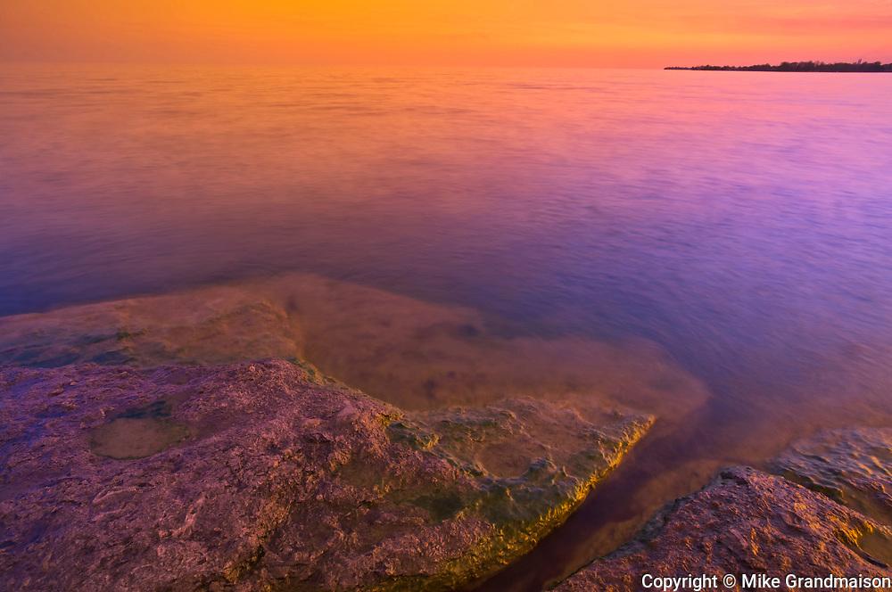 Morning light on rocky shoreline of Lake Erie<br />Selkirk<br />Ontario<br />Canada
