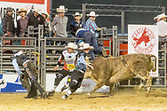 Bullfighters Cade Burns, in the dark shirt, and Nate Jestes protect Jeff Bertus from Summit Pro Rodeo's 298 Game Changer SM during the Xtreme Bulls event at the Elizabeth Stampede on Friday, June 1, 2018.