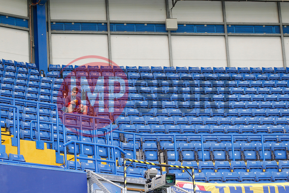 A lone fan sits in the stands  - Photo mandatory by-line: Mitchell Gunn/JMP - Tel: Mobile: 07966 386802 18/08/2013 - SPORT - FOOTBALL - Stamford Bridge - London -  Chelsea v Hull City - Barclays Premier League