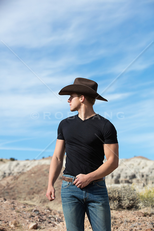 sexy hot cowboy on a rustic ranch in the mountains of New Mexico