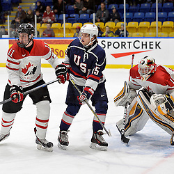 WHITBY, - Dec 18, 2015 -  Game #12 - Bronze Medal Game, Team Canada East vs. United States at the 2015 World Junior A Challenge at the Iroquois Park Recreation Complex, ON. Grant Jozefek #15 of Team United States and Sam Dunn #11 of Team Canada East battle for position in front of goaltender Colton Point #1 during the first period.<br /> (Photo: Shawn Muir / OJHL Images)