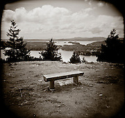 PL10310-00...WASHINGTON - Holga image of a bench on Orcas Island part of the San Juan Islands Group.