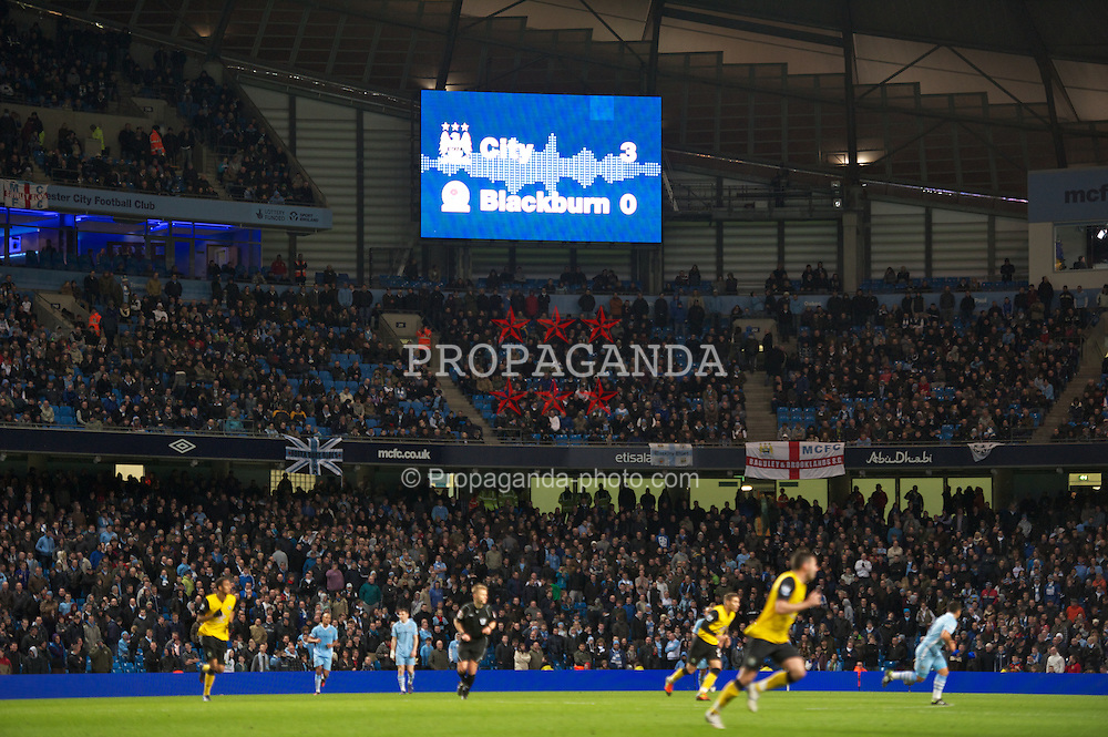 MANCHESTER, ENGLAND - Saturday, February 25, 2012: The scoreboard records Manchester City's 3-0 victory over Blackburn Rovers during the Premiership match at City of Manchester Stadium. (Pic by David Rawcliffe/Propaganda)