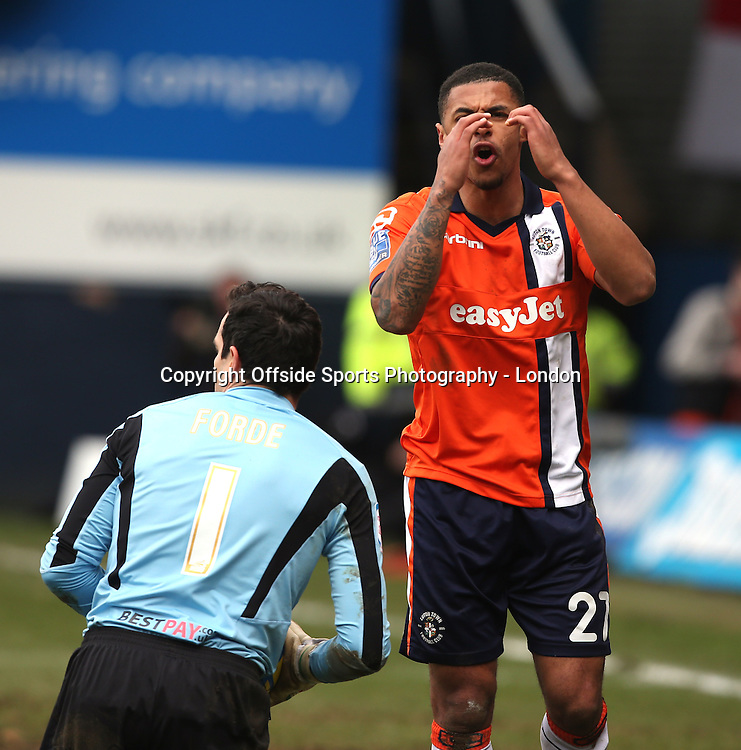 16 February 2013 FA Cup 5th round. Luton Town v Millwall.<br /> Dejection for Andre Gray as Millwall goalkeeper David Forde collects the ball.<br /> Photo: Mark Leech