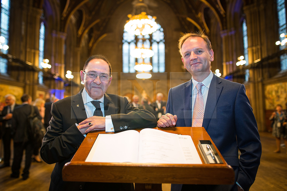 © Licensed to London News Pictures .02/09/2015 . Manchester , UK . SIR HOWARD BERNSTEIN and NHS England's SIMON STEVENS . Event and signing of a memorandum of understanding to mark partnerships between industry and the NHS , at the Great Hall at Manchester Town Hall . Service providers aim to improve access to cutting edge treatments within the NHS to patients in Greater Manchester , as part of the continuing devolution of the NHS in the region . Photo credit : Joel Goodman/LNP