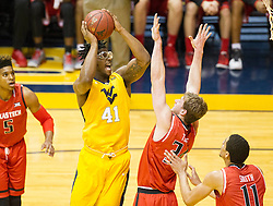Mar 2, 2016; Morgantown, WV, USA; West Virginia Mountaineers forward Devin Williams (41) shoots over Texas Tech Red Raiders forward Matthew Temple (34) during the first half at the WVU Coliseum. Mandatory Credit: Ben Queen-USA TODAY Sports