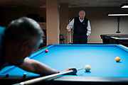 Bob Keller looks on during a game of billiards against Bernie Kapinos at Three Cushion Billiards in Madison, WI on Friday, May 10, 2019.