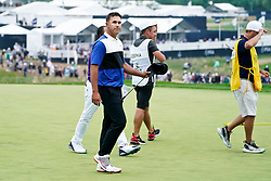 May 19, 2019 - Bethpage, New York, United States - Brooks Koepka walks off the 18th green after winning the 101st PGA Championship at Bethpage Black. (Credit Image: © Debby Wong/ZUMA Wire)