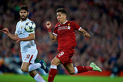 LIVERPOOL, ENGLAND - Tuesday, April 24, 2018: Liverpool's Roberto Firmino and AS Roma's Federico Fazio during the UEFA Champions League Semi-Final 1st Leg match between Liverpool FC and AS Roma at Anfield. (Pic by David Rawcliffe/Propaganda)