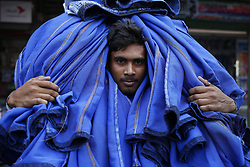 April 25, 2018 - Dhaka, Bangladesh - A man makes a delivery of washed garments to a warehouse in Dhaka. (Credit Image: © Md. Mehedi Hasan via ZUMA Wire)
