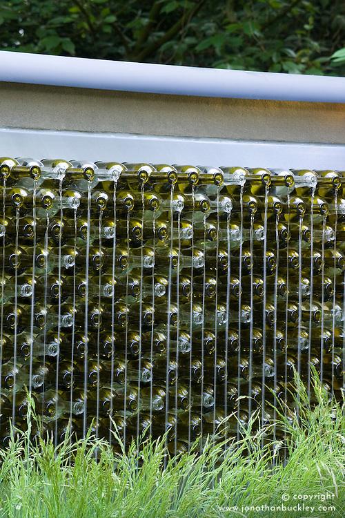 Recycled wine bottle water feature. Simon's Garden with Va Va Voom. Design: Scenic Blue Design Team - Chelsea 2005