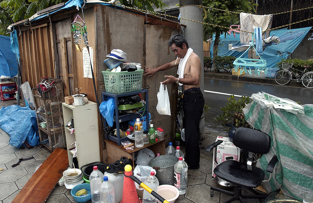 One of many of Osaka's homeless with his makeshift shack bewteen Tennoji and Shinimamiya Stations in Kamagasaki District. 20/06/02..©David Dare Parker/AsiaWorks Photography