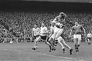 Kerry catches the ball in the air but Dublin players move in behind him during the All Ireland Senior Gaelic Football Final Dublin v Kerry in Croke Park on the 26th September 1976. Dublin 3-08 Kerry 0-10.