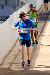 Lance Barrett and Ricky Rasetlola during the 2016 Sanlam Cape Town marathon held in Cape Town, South Africa on the 18th September  2016<br /> <br /> Photo by: John Tee / RealTime Images