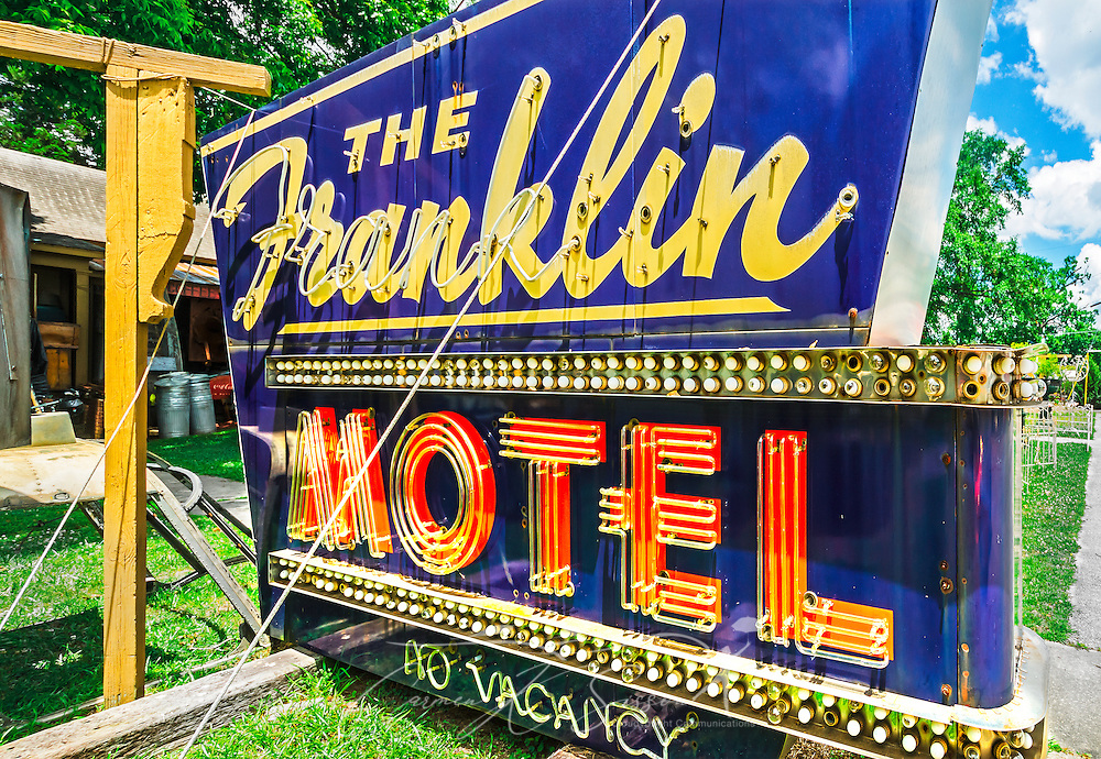 A sign from Franklin Motel sits on the front lawn at Biggar's Antiques in Chamblee, Georgia, June 10, 2014. The family-owned shop was founded in New York and supplies props for many of Hollywood's most popular movies. (Photo by Carmen K. Sisson/Cloudybright)