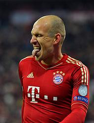 13.03.2013, Fussball Champions League Achtelfinale Rückspiel: FC Bayern München - FC Arsenal London, In der Allianz-Arena München. Arjen Robben (Bayern München) sticks out his tongue after missing a chance.