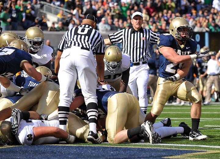 Navy Midshipmen linebacker Aaron McCauley (29) signals a successful goal line stand as the Irish failed to get the ball over the goal line on their first possesion.