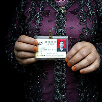 URUMQI, JULY-15 : the mother of Zora Gudi  who was arrested during the protest on July 7, 2009 holds-up a picture of her son in the Xiangyang Po district,   a poor quarter of the city dominated by Uighurs, Turkic-speaking Muslims who have often had an uneasy relationship with China's Han majority. Uighurs are the largest ethnic group in Xinjiang, but in Urumqi, Han make up more than 70 percent of the 2.3 million residents.<br /> Many Han Chinese were killed in Xiangyang Po during the protests in early July 2009.