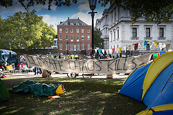 © Licensed to London News Pictures. 09/10/2019. London, UK. Extinction Rebellion activists camp out in St James's Park in sight of Downing Street as they take part in a third day of protests in central London. The climate change group intend to blockade the Westminster area for two weeks to demand that the government takes immediate and decisive action on climate change. Photo credit: Peter Macdiarmid/LNP