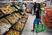 Mestilde Shigwedha, a diamond polisher for NamCot Diamonds in Windhoek, Namibia, shops for groceries at a supermarket near her home.  (Mestilde Shigwedha is featured in the book What I Eat: Around the World in 80 Diets.) MODEL RELEASED.