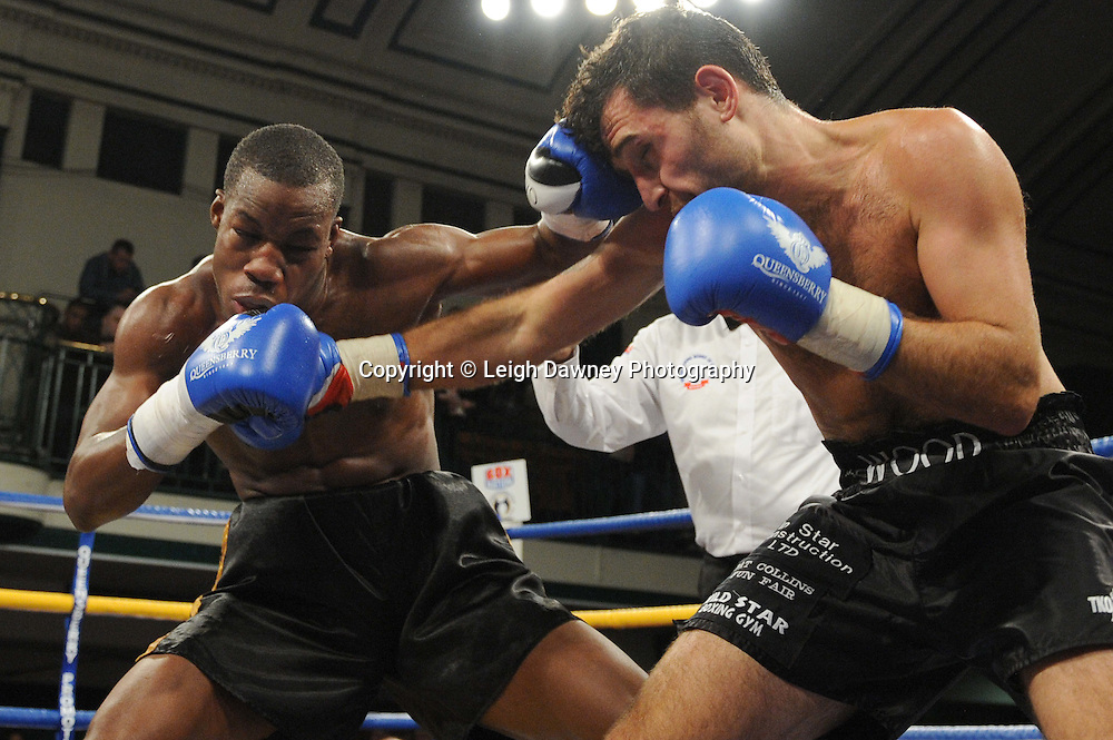 Darryll Williams (black/gold shorts) defeats Bobby Wood in a 4x3 min Light Heavyweight contest at York Hall, Bethnal Green, London on Friday 13th January 2012. Queensbury Promotions © Leigh Dawney 2012