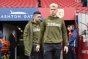 Leeds United midfielder Ezgjan Alioski (10) and Leeds United midfielder Pablo Hernandez (19) inspect the pitch during the EFL Sky Bet Championship match between Bristol City and Leeds United at Ashton Gate, Bristol, England on 9 March 2019.
