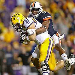 Sep 21, 2013; Baton Rouge, LA, USA; LSU Tigers tight end Travis Dickson (41) is tackled by Auburn Tigers defensive back Jermaine Whitehead (9) during the second half of a game at Tiger Stadium. LSU defeated Auburn 35-21. Mandatory Credit: Derick E. Hingle-USA TODAY Sports
