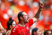 A Charlton fan celebrates at full time during the EFL Sky Bet Championship match between Charlton Athletic and Brentford at The Valley, London, England on 24 August 2019.