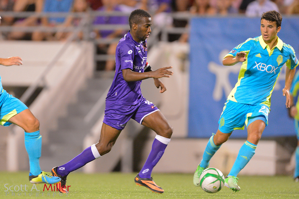 Orlando City Lions midfielder Kevin Molino (18) brings the ball upfield ball during a USL Pro soccer game against theSeattle Sounders at the Citrus Bowl on Aug. 11, 2013 in Orlando, Florida. <br /> <br /> &copy;2013 Scott A. Miller