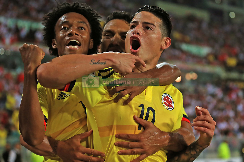 LIMA, Oct. 11, 2017  Colombia's James Rodriguez (R) celebrates after scoring during the Russia 2018 FIFA World Cup qualifier match against Peru, at the National Stadium of Lima, in Lima, Peru, on Oct. 10, 2017. The match ended in a draw 1-1.  ma) (da) (Credit Image: © Andina/Xinhua via ZUMA Wire)
