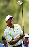 Tiger Woods of the US reacts to his tee shot on the fourth hole during the first day of the US Open Golf Championship at Winged Foot Golf Club in Mamaroneck, New York Thursday, 15 June 2006.