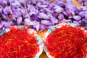 TALIOUINE, MOROCCO - October 27th 2015 - Plate of saffron threads surrounded by saffron (crocus sativus) flowers and petals, Taliouine, Morocco
