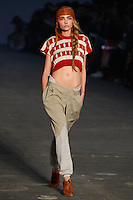 Snejana Onopka walks the runway wearing Alexander Wang Spring 2010 collection during Mercedes-Benz Fashion Week in New York, NY on September 11, 2009