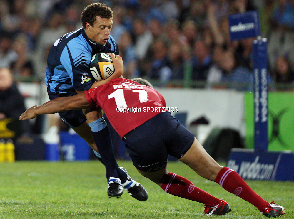 PRETORIA, South Africa, Zane Kirchner tackled by Brando Va'aulu during the Super 14 match between the Bulls and the Reds held at Loftus Versfeld in Pretoria on the 14 February 2009..Photo By Barry Aldworth/ SPORTZPICS