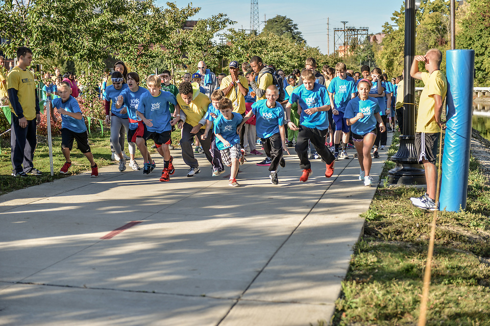 Children racing at the start of the Kids Fun Run.