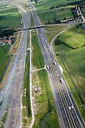 Nederland, Gelderland, Meteren, 28-06-2006;  voltooide Betuweroute, parallel aan A15; de Betuwelijn is een aparte goederen spoorlijn, maar op deze lokatie zijn er verbindingen (in- en uittakkingen in het jargon) met het gewone spoorwegnet, richting Culemborg - Uttrecht en richting Den Bosch, vandaar het grote aantal sporen op deze lokatie; oorspronkelijk stonden er hier een aantal boerderijen (zie reguliere foto's); bouw, transport, infrastructuur, verkeer en vervoer, mobiliteit, rails, rijstroken, wegververvoer, planologie; zie ook luchtfoto van bouwfase; deel van de serie Panorama Nederland luchtfoto (toeslag); aerial photo (additional fee required); .foto Siebe Swart / photo Siebe Swart
