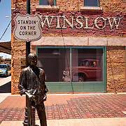 "WINSLOW, AZ/USA - June 13: ""Standin' On The Corner Park"", pays homage to ""Take It Easy"", a song written by Jackson Browne and popularized by the rock group Eagles, on June 13, 2004, in Winslow, Arizona."