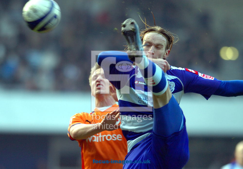 London - Saturday January 31st, 2009: Kaspars Gorkss of QPR in action against Kevin Doyle of Reading during the Coca Cola Championship match at Loftus Road, London. (Pic by Focus Images)