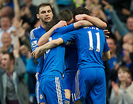 Picture by Alan Stanford/Focus Images Ltd +44 7915 056117.08/05/2013.Oscar of Chelsea celebrates after scoring with his team mates during the Barclays Premier League match at Stamford Bridge, London..