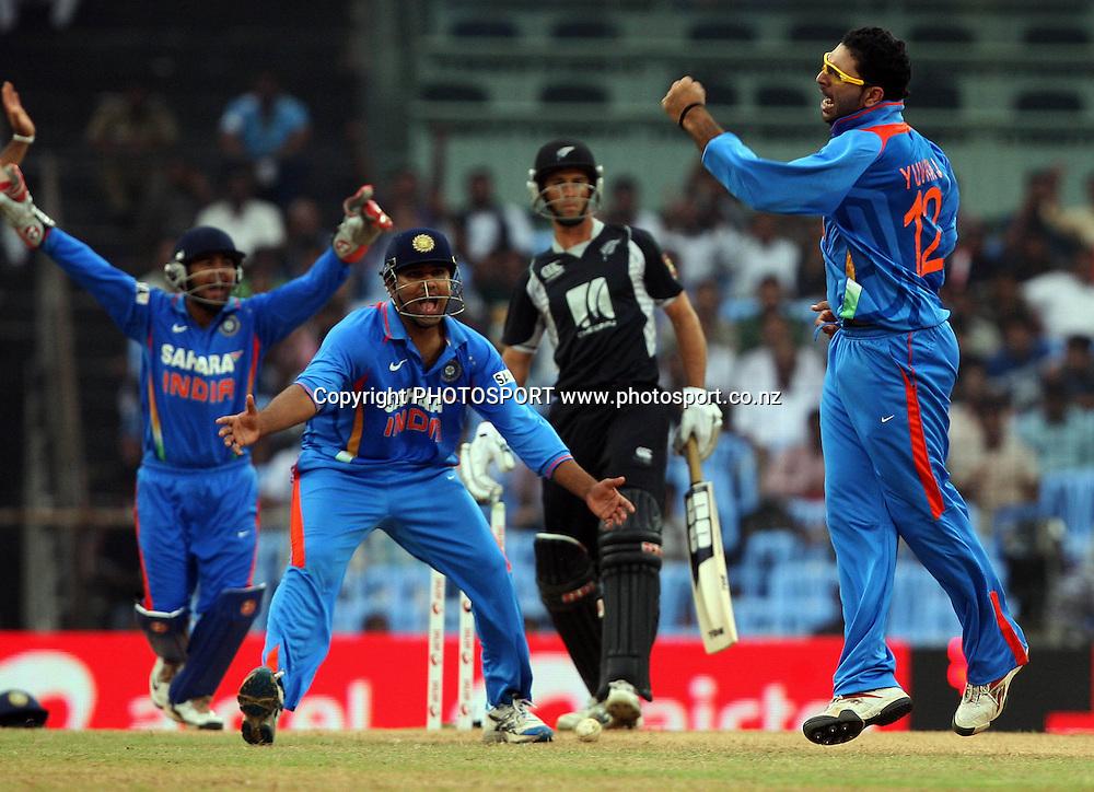 Indian bowler Yuvraj Singh celebrates New Zealand batsman Grant Elliott wicket during the India vs New Zealand 5th ODI Played at MA Chidambaram Stadium, Chepauk, Chennai, 10 December 2010 - day/night (50-over match)