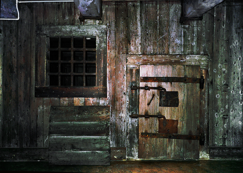 Door and window of a wooden jail cell (one of many) under the roof of the Doges Palace, Venice.  Casanova was one of its occupants..