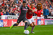Leeds United midfielder Pablo Hernandez (19) and Barnsley defender Jordan Williams (2) during the EFL Sky Bet Championship match between Barnsley and Leeds United at Oakwell, Barnsley, England on 15 September 2019.