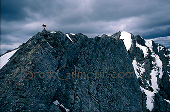 Hugo Cozar celebrates on the summit of Mt. Lady MacDonald near Canmore, Alberta, Canada.