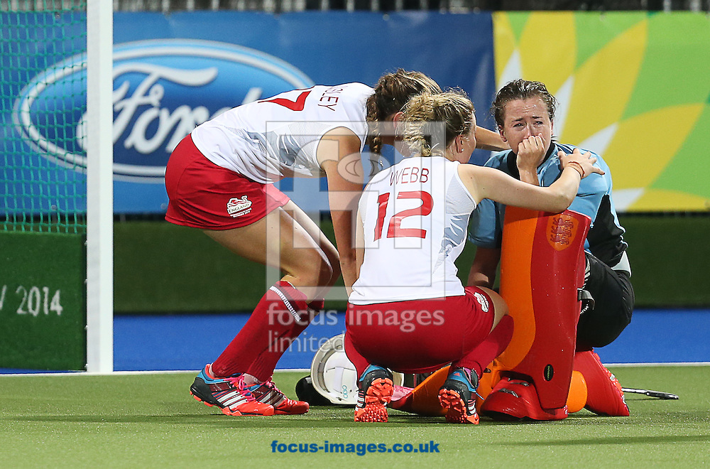 England Goalkeeper Maddie Hinch is consoled by Giselle Ansley ( L ) and Hollie Webb after their defeat in the Women's final during day ten of the Hockey at Glasgow National Hockey Centre, during the Glasgow 2014 Commonwealth Games.<br /> Picture by Paul Terry/Focus Images Ltd +44 7545 642257<br /> 02/08/2014