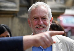 © London News Pictures. 09/05/2016. London, UK. The hand of Labour deputy leader TOM WATSON seen pointing in front of Leader of the Labour Party, JEREMY CORBYN, as he greets new Labour MPs Chris Elmore and Gill Furniss (not pictured) outside the Houses of Parliament in London following elections last week. Photo credit: Ben Cawthra/LNP