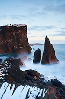 Valahnjúkur at Reykjanestá, Sea stacks in evening light, Reykjanes Peninsula, Iceland.
